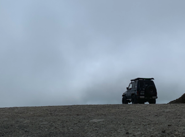 Jeep overlooking a clouded valley
